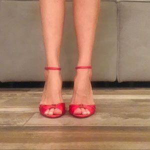 GUESS Red Heels with Gold G charm.